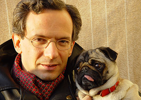 Fabio Luisi, with one of his pugs
